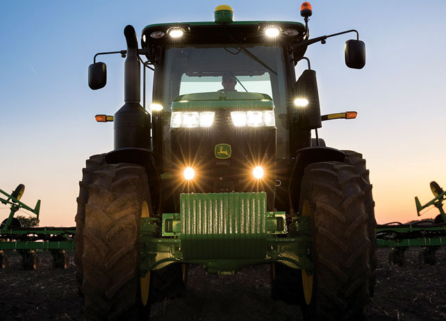7250R Tractor working in a field at sunset