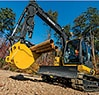 75G Excavator with auxiliary hydraulics using the excavator thumb on the bucket to carry pipes