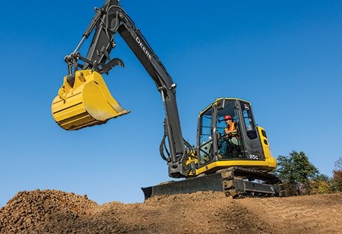 85G Excavator with auxiliary hydraulics and excavator thumb on the bucket
