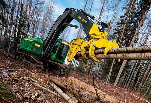 903M Tracked Feller Buncher stacking logs using the felling head