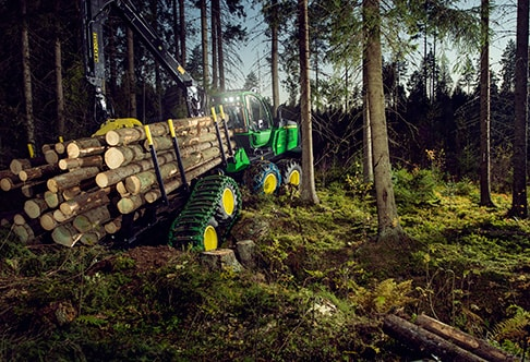 1110E Forwarder driving through the forest