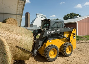 Loader with hay bale