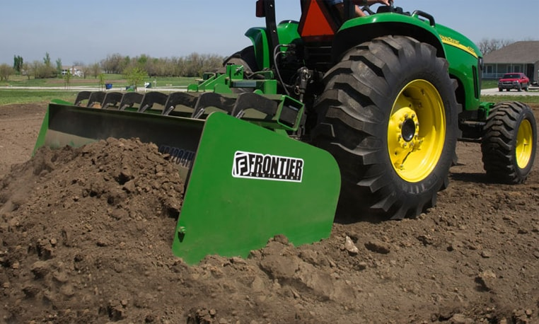 Box Blade attached to tractor moves dirt