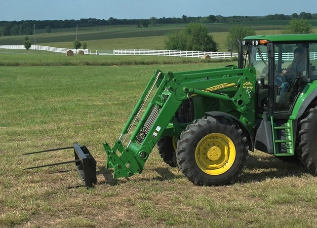AB14 Series Bale Spear drives through pasture