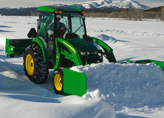 John Deere tractor using a AS11E Snow Push to clear snow