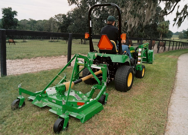 GM10E Series Grooming Mower cuts grass along horse pasture