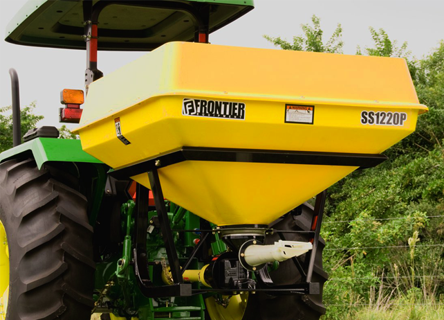 Closeup of a SS12P Series Pendular Spreader on the back of a John Deere tractor