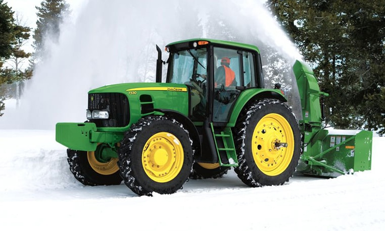 Snow Removal Equipment working on a Deere tractor
