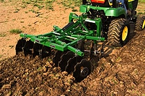 DH10 Series Disk Harrows tilling a field
