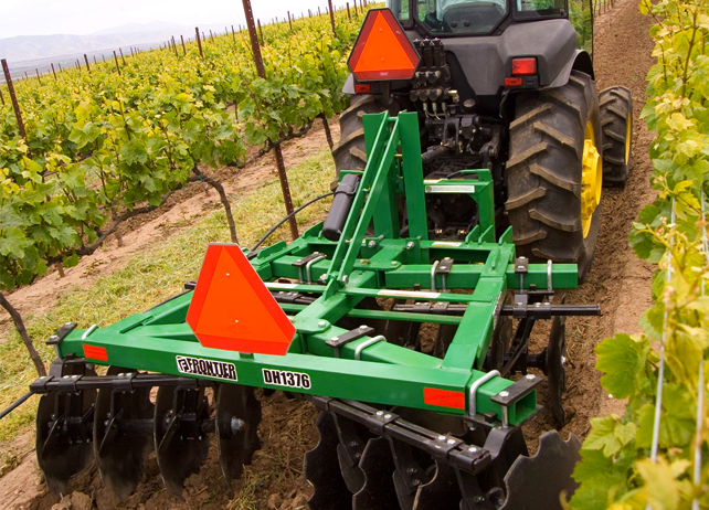DH13 Series Disk Harrows working in a vineyard