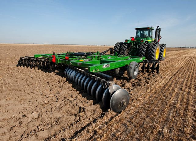 John Deere tractor using TM51 Series Disk Harrows to till a field