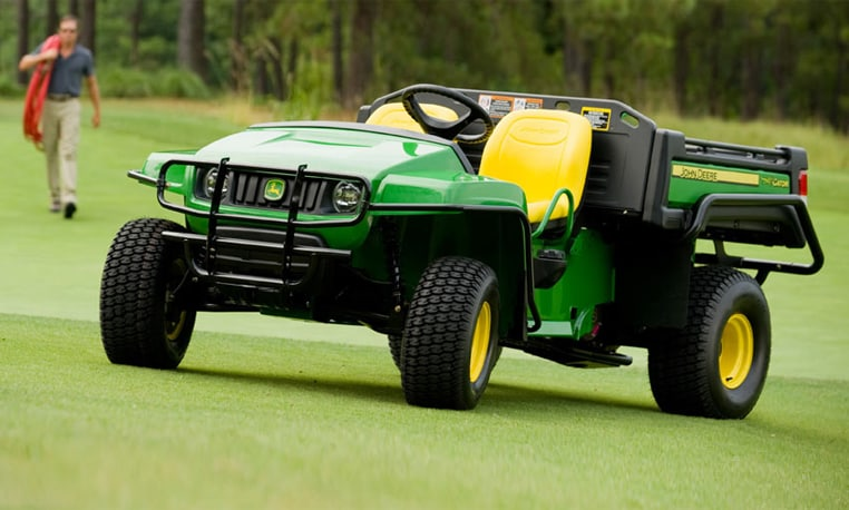 Gator Turf Vehicle on a golf course with a crew member in the background