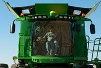Farmer inside the cab of an S-Series Combine