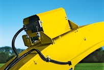 closeup of the Harvestlab device mounted on a John Deere self-propelled forage harvester