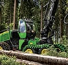 1270G Wheeled Harvester with H480C harvesting head after sawing tree