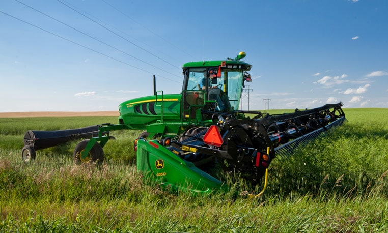 John Deere 400 Series Windrower working in a field