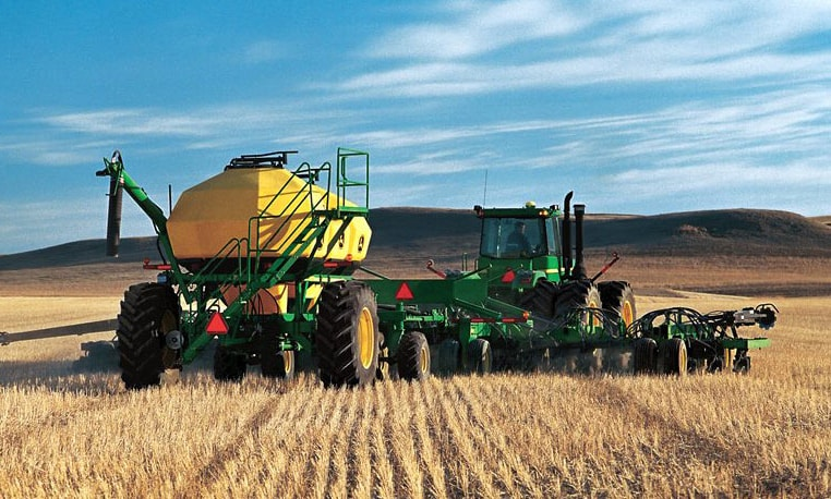 John Deere Tractor in a field using the No-Till Air Drill Series