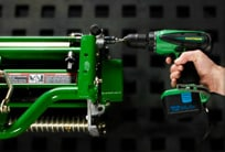 Close-up of a cordless drill adjusting the Cutting Units on a PrecisionCut mower