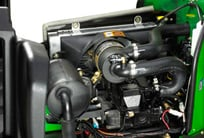 Close-up of the engine compartment under the hood of the PrecisionCut mower