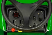 Close-up of the steering column of the PrecisionCut mower