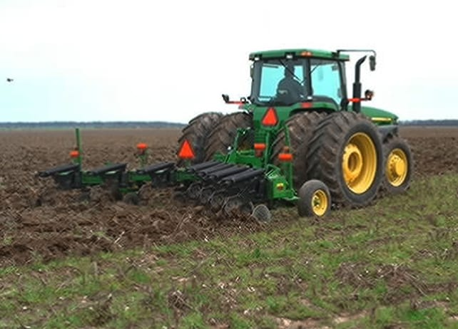 915 V-Ripper attached to John Deere tractor working up a field