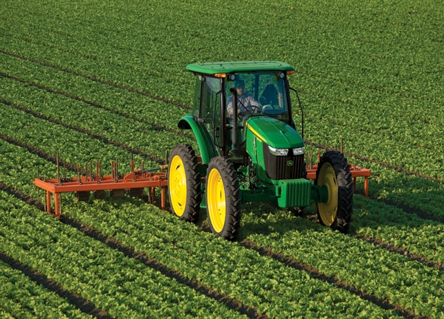 5100MH Hi-Crop Utility Tractor in a field