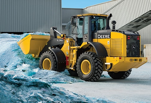 624K wheel loader dumping a bucket full of recycled glass