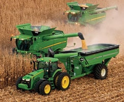 Photo of tractors using Machine Sync to transfer grain