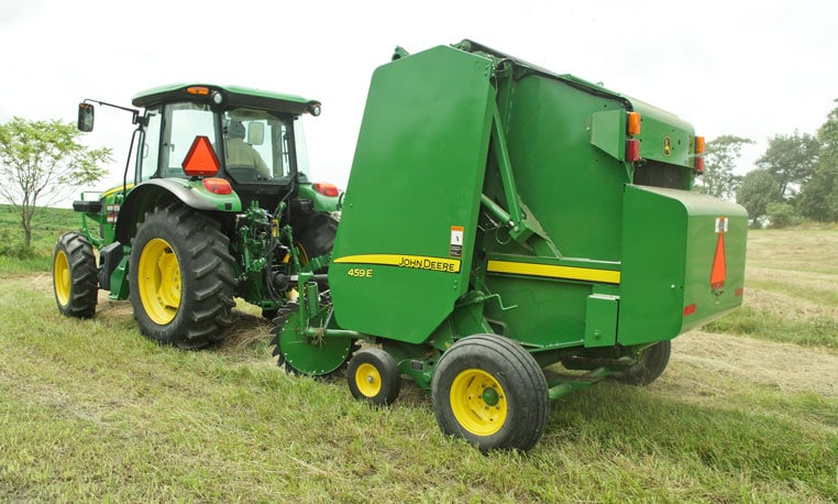 Image of a 459E Baler hero in a field.