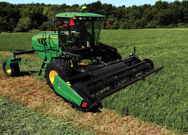 Image of W155 Windrower in a field.