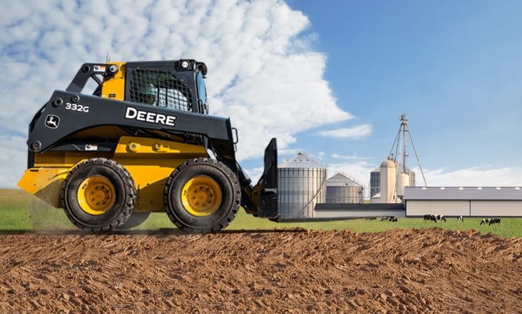 G-Series Skid Steer appearing to life a barn and silo.  Learn more.