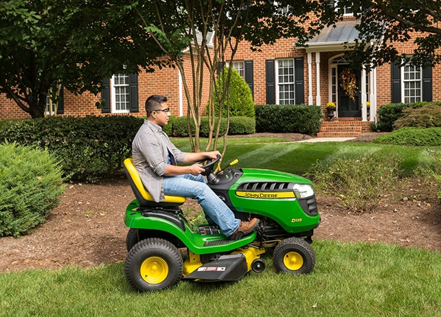 Man drives D125 lawn tractor on his residential property.