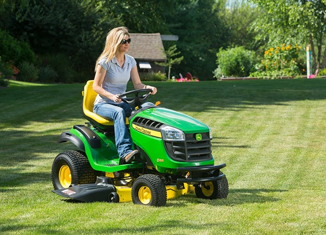 Woman riding D155 lawn tractor