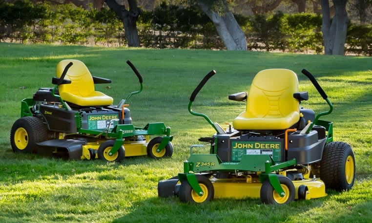 Image of two Residential ZTrak™ mowers in shady lawn