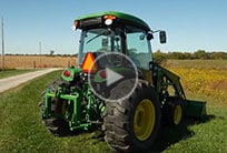 Image of a 4 series tractor in a field.