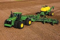 Overhead view of a 9570R Tractor with planting attachment in a field