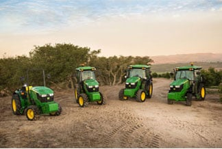 Photo of 5g tractors with mountains in the background.