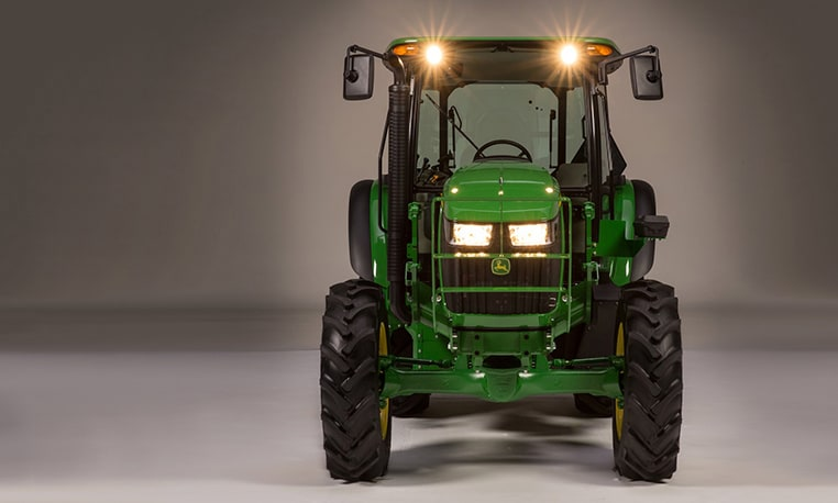 Front view of tractor in dim studio lighting to show off LED lights